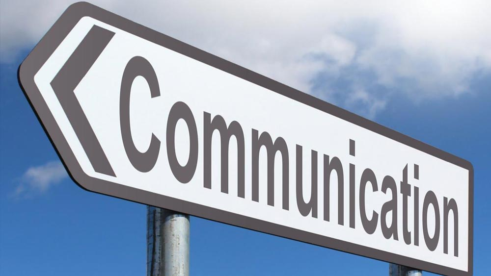 """communication"" on a sign"
